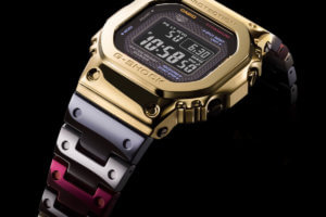 G-Shock GMW-B5000TR-9 with TranTixxii titanium alloy, mirror finish, gold ion plating, and multicolor IP band
