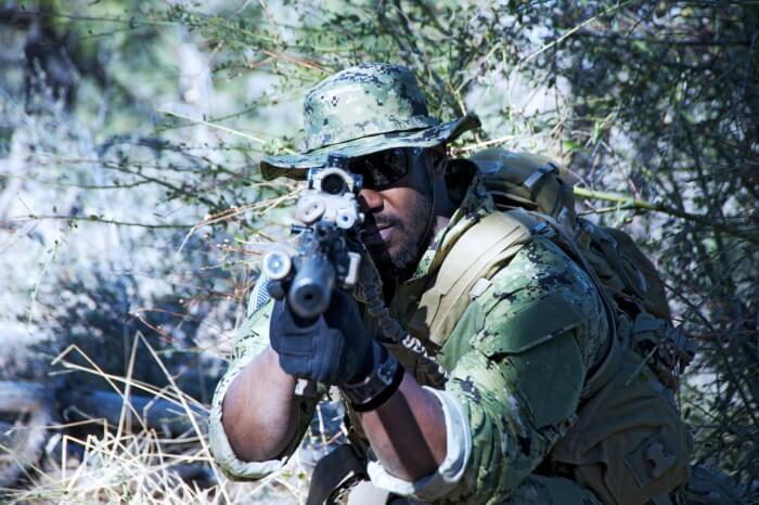 Woodland camouflage-outfitted Navy SEAL wearing a G-Shock watch military-style