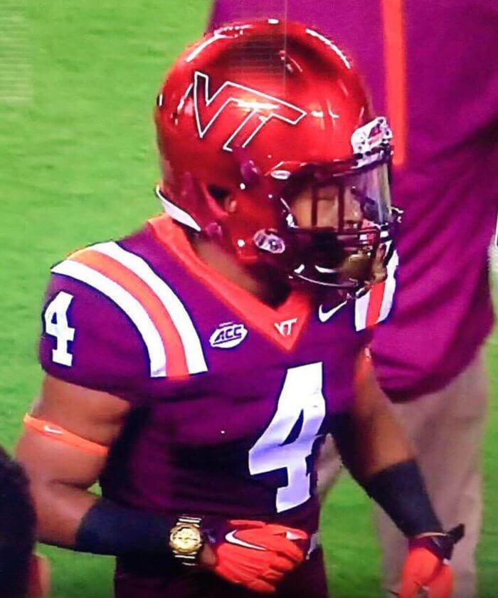 Virginia Tech J.C. Coleman wearing gold G-Shock during football game